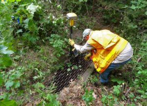 Engineer surveying East Vadnais Lake outlet